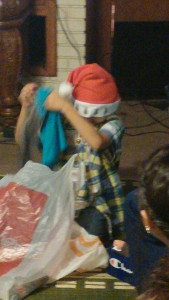 my baby brother opening his presents . . . SURPRISE YOU GET CLOTHES!!!